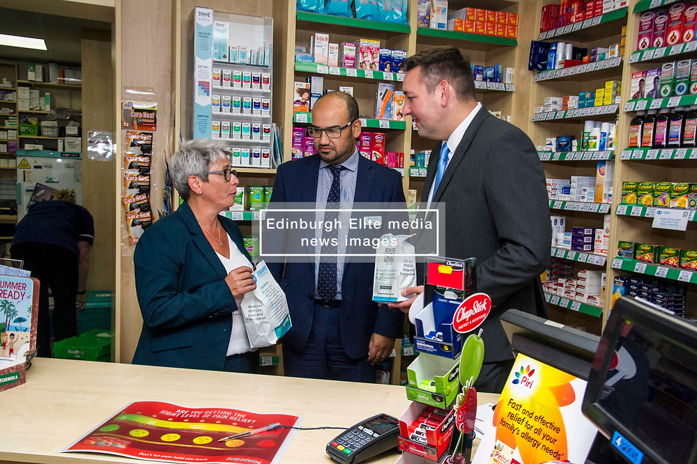 Pictured: Phamacist Mahyar Nickkho-Amiry explained how his pharmacy operated yo Miles Briggs and Annie Wells <br /> <br /> The shadow health secretary Miles Briggs and public health spokesman Annie Wells visited Dears Pharmany in Oxgangs, Edinburgh, today to announce the initiative to make pharmacies a key partner in primary health care.  <br /> <br /> Ger Harley   EEm 27 July 2018