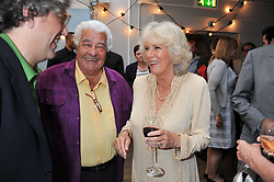 Left to right, GIORGIO LOCATELLI, ANTONIO CARLUCCIO and HRH The DUCHESS OF CORNWALL at a party to celebrate the publication on 'Let's Eat: Recipes From My Kitchen Notebook' by Tom Parker Bowles held at Selfridge's Rooftop. Selfridge's, Oxford Street, London on 27th June 2012.