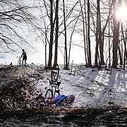 The thrills and spills of the Newtown CX, Cyclocross Event as competitors navigate a slippery slope of mud and melting snow. The event was organized by The Connecticut Cycling Advancement Program and Team 26, a group of cyclists affected by the tragedy at Sandy Hook School. Fairfield Hills, Newtown, Connecticut, USA. 21st December 2013. Photo Tim Clayton