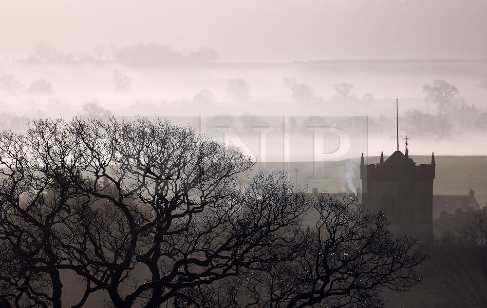 © Licensed to London News Pictures. 22/01/2014. Somerset, UK Ditcheat church in Somerset shrouded in mist this morning 22 January 2014. Photo credit : Jason Bryant/LNP