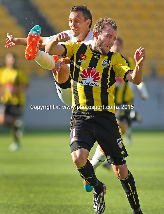 Phoenix' Jeremy Brockie & Brisbane Roar' Jade North compete for the ball during the A-League football match between the Wellington Phoenix & Brisbane Roar at Westpac Stadium, Wellington. 4th January 2015. Photo.: Grant Down / www.photosport.co.nz