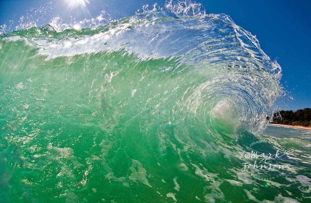 Beautiful delicate wave breaking off the coast of Queensland, Australia