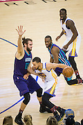 Golden State Warriors guard Stephen Curry (30) handles the ball against the Charlotte Hornets at Oracle Arena in Oakland, Calif., on February 1, 2017. (Stan Olszewski/Special to S.F. Examiner)
