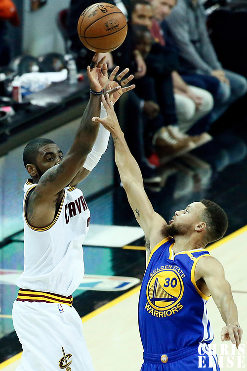07 June 2017: Cleveland Cavaliers guard Kyrie Irving (2) takes a jump shot over Golden State Warriors guard Stephen Curry (30) during the Golden State Warriors 118-113 victory over the Cleveland Cavaliers, in game 3 of the 2017 NBA Finals, at  the Quicken Loans Arena, Cleveland, Ohio, USA.
