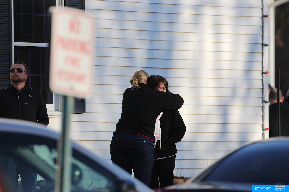 Unidentified people, believed to be parents and relatives, consoled near fire station in Sandy Hook after today's shootings at Sandy Hook Elementary School, Newtown, Connecticut, USA. 14th December 2012. Photo Tim Clayton