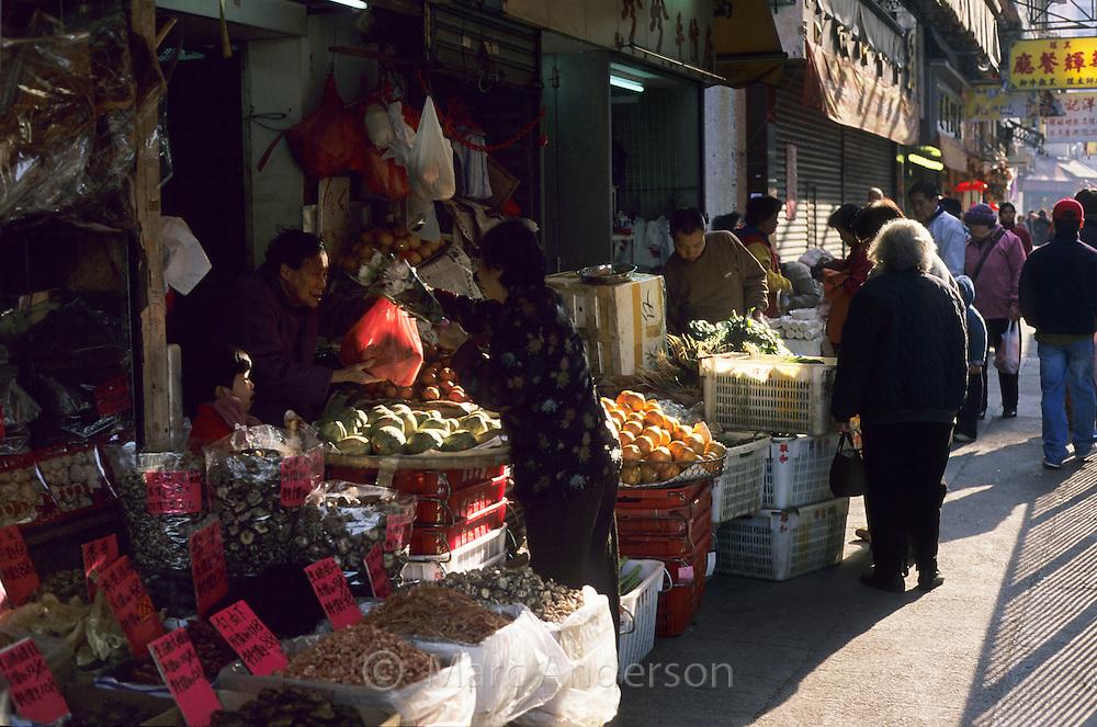 A market stall & people in Tai Po market, Hong Kong, China.