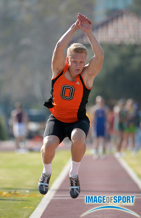 Feb 24, 2013; Claremont, CA, USA; Kase Rattey of Occidental College competes in the triple jump  in the 17th Rossi Relays at the Burns Track & Field Complex.
