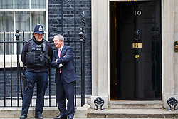 © Licensed to London News Pictures. 19/05/2016. London, UK. Former Mayor of New York City and business magnate MICHAEL BLOOMBERG chat with a police officer whilst leaving Downing Street in London after a meeting with Prime Minister David Cameron on dangers of possible 'Brexit' and Britain's EU referendum on Thursday, 19 May 2016. Photo credit: Tolga Akmen/LNP