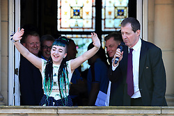 Local singer Cody Frost featuring on 'The Voice' acknowledges the crowd with Alastair Campbell - Mandatory by-line: Matt McNulty/JMP - 09/05/2016 - FOOTBALL - Burnley Town Hall - Burnley, England - Burnley FC Championship Trophy Presentation