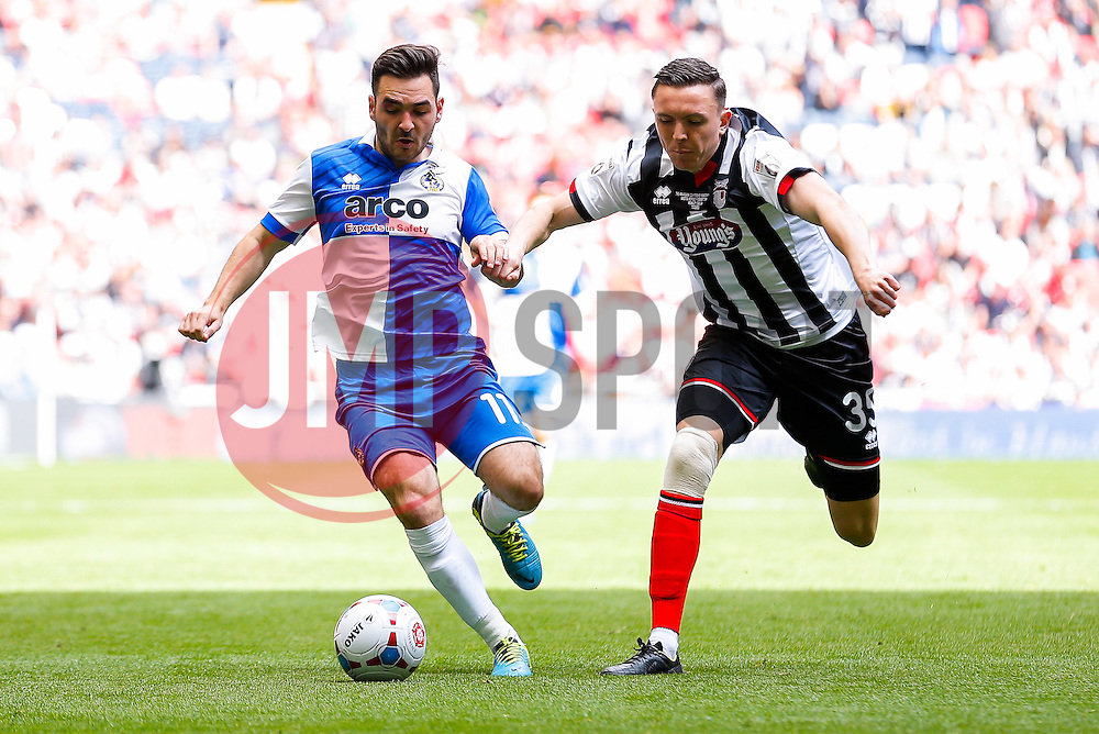 Jake Gosling of Bristol Rovers is challenged by Gregor Robertson of Grimsby Town - Photo mandatory by-line: Rogan Thomson/JMP - 07966 386802 - 17/05/2015 - SPORT - FOOTBALL - London, England - Wembley Stadium - Bristol Rovers v Frimsby Town - Vanarama Conference Premier Play-off Final.