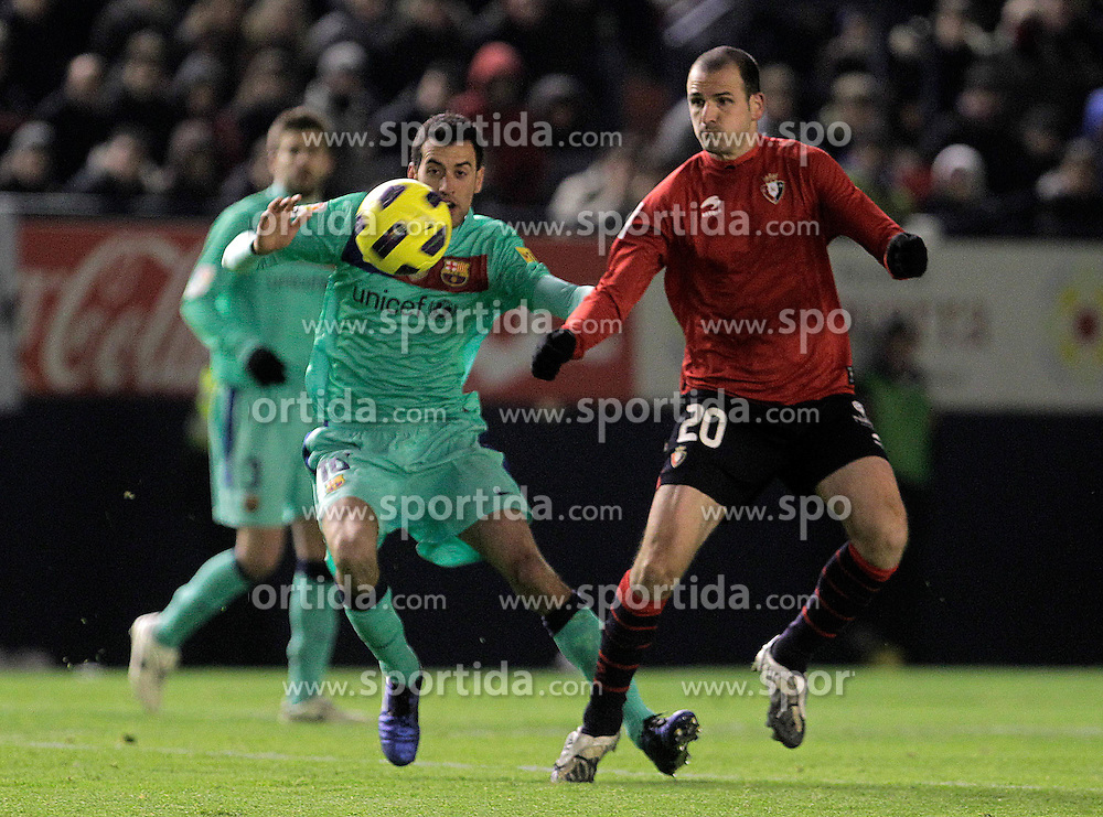 04.12.2010, Estadio Reyno de Navarra, Pamplona, ESP, Primera Division, Real Madrid vs FC Valencia, im Bild Osasuna's Fernando Soriano (r) and FC Barcelona's Sergio Busquets during La Liga match.December 04,2010. . EXPA Pictures © 2010, PhotoCredit: EXPA/ Alterphotos/ Acero +++++ ATTENTION - OUT OF SPAIN / ESP +++++
