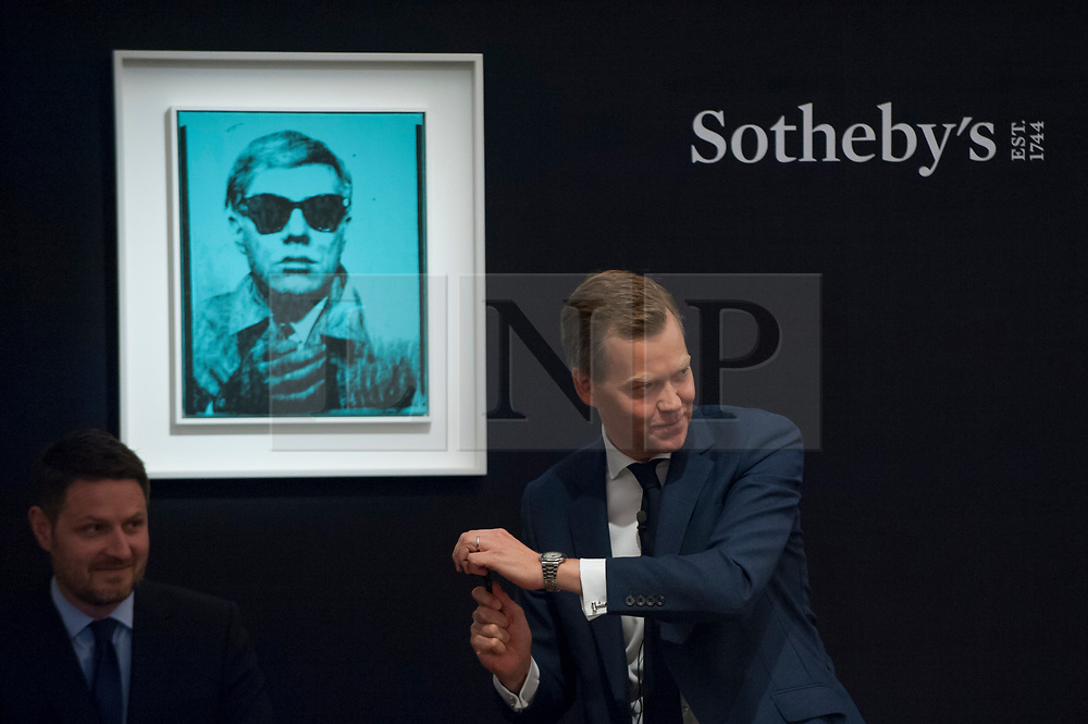 """© Licensed to London News Pictures. 28/06/2017. London, UK. """"Self-Portrait"""", 1963-64, by Andy Warhol sold for a hammer price of GBP5.2m (estimate GBP5-7m) at Sotheby's Contemporary Art evening sale in New Bond Street, which featured pioneering works from the Pop Art genre. Photo credit : Stephen Chung/LNP"""