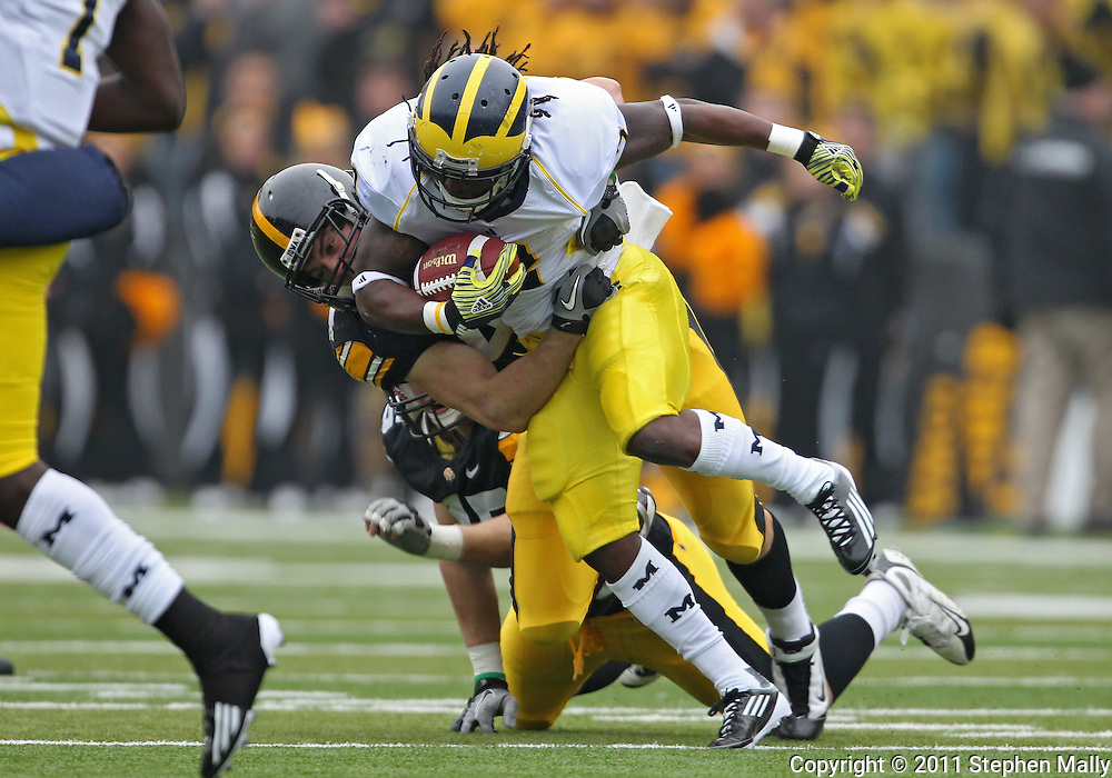 November 05, 2011: Michigan Wolverines running back Vincent Smith (2) is brought down by Iowa Hawkeyes linebacker James Morris (44) during the first quarter of the NCAA football game between the Michigan Wolverines and the Iowa Hawkeyes at Kinnick Stadium in Iowa City, Iowa on Saturday, November 5, 2011. Iowa defeated Michigan 24-16.
