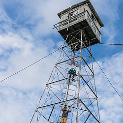 Climbing the fire tower on Deboullie Mountain in Aroostook County, Maine. Deboullie Public Reserve Land.