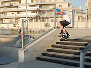Urban extreme sport park. Young skateboarder performs stunts with a skateboard