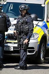 © Licensed to London News Pictures. 30/06/2015. London, UK. Armed police enter the building. Members of the emergency service take part in a mocked-up terrorist firearms attack at Aldwych station in central London. The exercise is the biggest to take place in London and is happening a week after dozens of people where killed when a gunman opened fire on a beach in Tunisia.  Photo credit: Ben Cawthra/LNP