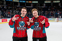 KELOWNA, CANADA - MARCH 16:  Ethan Ernst #19 and Michael Farren #16 of the Kelowna Rockets ham it up for the camera after the OT win against the Vancouver Giants on March 16, 2019 at Prospera Place in Kelowna, British Columbia, Canada.  (Photo by Marissa Baecker/Shoot the Breeze)
