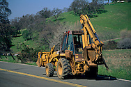 Tractor on country road, near Amador City, Sierra Foothills, Amador County, California
