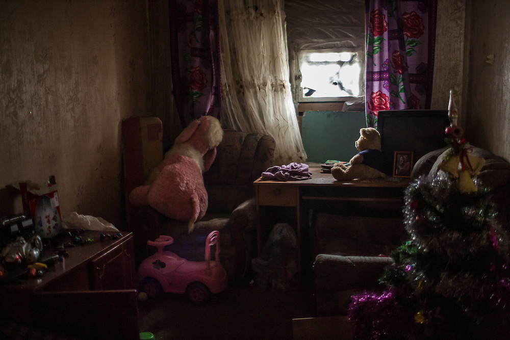DONETSK, UKRAINE - JANUARY 29, 2015: The bedroom belonging to Aleksandr and Katerina Dynya's children in the Petrovskyi district of Donetsk, Ukraine. The family fled heavy shelling to a nearby underground bomb shelter several days ago and returned to find shrapnel had broken the window of their children's room and left craters in the wall. CREDIT: Brendan Hoffman for The New York Times