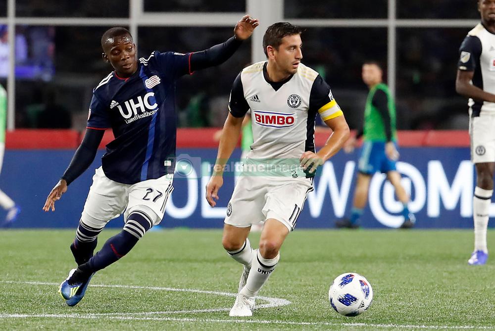August 11, 2018 - Foxborough, MA, U.S. - FOXBOROUGH, MA - AUGUST 11: Philadelphia Union midfielder Alejandro Bedoya (11) turns away from New England Revolution midfielder Luis Caicedo (27) during an MLS match between the New England Revolution and the Philadelphia Union on August 11, 2018, at Gillette Stadium in Foxborough, Massachusetts. The Union defeated the Revolution 3-2. (Photo by Fred Kfoury III/Icon Sportswire) (Credit Image: © Fred Kfoury Iii/Icon SMI via ZUMA Press)