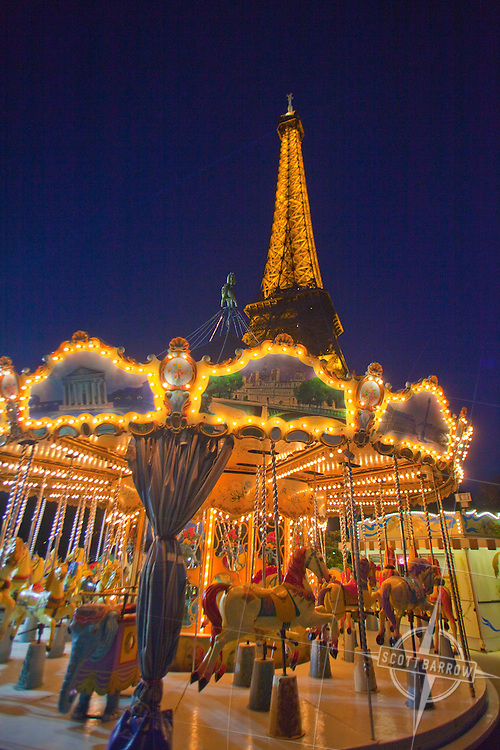 Carousel at the Eiffel Tower, Paris France at night.