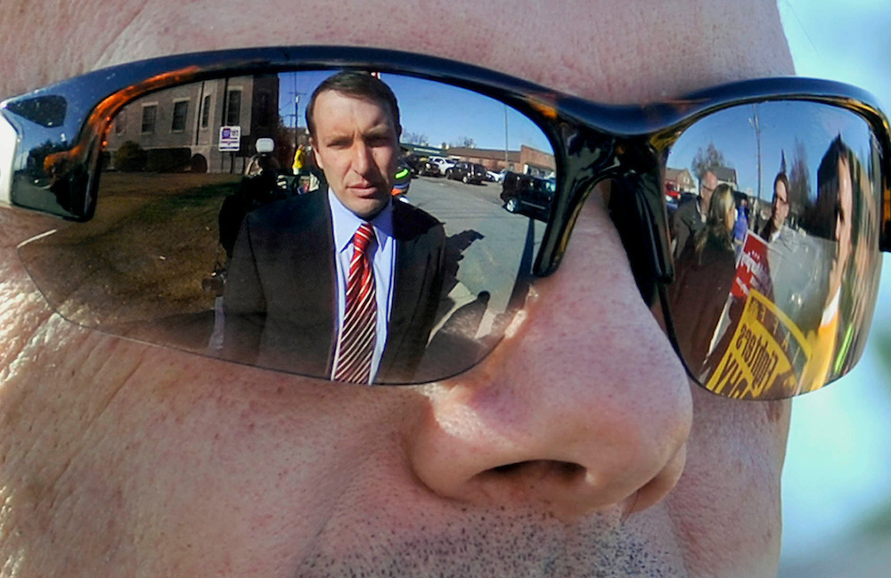 Democratic candidate for U.S. Senate Chris Murphy is reflected in the sunglasses of supporter Dan Pullium during a campaign stop in Torrington, Conn. Murphy and Republican opponent Linda McMahon are vying for the Senate seat now held by Joe Lieberman, an independent who's retiring. (AP Photo/Jessica Hill)..
