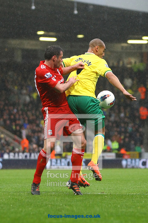 Picture by Paul Chesterton/Focus Images Ltd.  07904 640267.28/04/12.James Vaughan of Norwich and Jamie Carragher of Liverpool in action during the Barclays Premier League match at Carrow Road Stadium, Norwich.