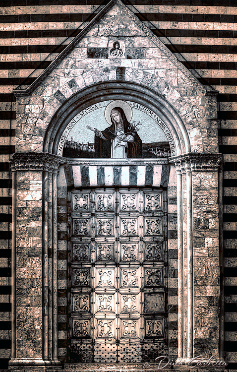 """""""Holy Door of the Church of Saint Agnes of Montepulciano – BW""""…<br /> <br /> St. Agnes of Montepulciano was born in 13th-century Tuscany. At the age of six, Agnes began trying to convince her parents to allow her to join a convent. She was finally admitted to the Dominican convent at Montepulciano at age nine.<br /> Agnes' reputation for holiness attracted other sisters, and she became an abbess at the unheard of age of 15. She insisted on greater austerities in the abbey. She lived on bread and water for 15 years, slept on the ground and used a stone for a pillow. It was said that she had visions of the Virgin Mary and that in her visions angels gave her Communion. She also had a vision in which she was holding the infant Jesus. When she awoke from her trance, she she was holding the small gold crucifix the infant Jesus was wearing. She died in 1317. Miracles have been reported at her tomb. When her body was moved to a church years after her death, it was found incorrupt. She was canonized in 1726. The saint's shrine is located facing the 16th century ramparts of the Porta al Prato of Montepulciano. It opens into the lower part of the historical center and completed in 1306. The hill was chosen by the saint to build her church following visions of a stairway to heaven, it was originally occupied by brothels. Agnes purchased the land herself for 1,200 lire. The hill was transformed from a sinful location to a holy and reverent community. The church, monumental cloister, and its convent are now totally transformed and host the incorrupt body of Saint Agnes."""