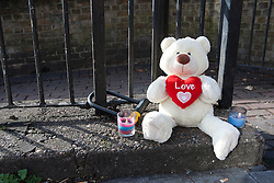 © licensed to London News Pictures. London, UK 08/03/2012. A teddy bear and candles next to Regents Canal in east London where a torso, thought to be that of TV actress Gemma McCluskie's  was found yesterday. Photo credit: Tolga Akmen/LNP
