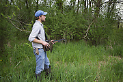 Coyote <br /> Canis latrans<br /> Andy Burmesch, Wildlife Research Technician with the Cook County Coyote Project, tracking coyote with radio collar<br /> Chicago, Illinois<br /> *Model releae available
