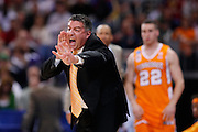 ST. LOUIS, MO - MARCH 26: Head coach Bruce Pearl of the Tennessee Volunteers yells to his team in the game against the Ohio State Buckeyes during the Midwest regional semi-final of the NCAA men's basketball tournament at the Edward Jones Dome on March 26, 2010 in St. Louis, Missouri. Tennessee advanced with a 76-73 win. (Photo by Joe Robbins)