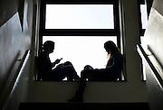Nederland, Nijmegen, 22-2-2014Meisjes, tieners, pubers, in een school  bezig met social media op de gsm, smartphone,mobiel,mobiele, telefoon.Foto: Flip Franssen/Hollandse Hoogte