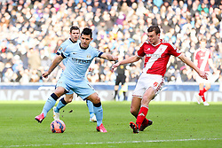 Manchester City's Sergio Aguero and Middlesbrough's Ben Gibson in action - Photo mandatory by-line: Matt McNulty/JMP - Mobile: 07966 386802 - 24/01/2015 - SPORT - Football - Manchester - Etihad Stadium - Manchester City v Middlesbrough - FA Cup Fourth Round