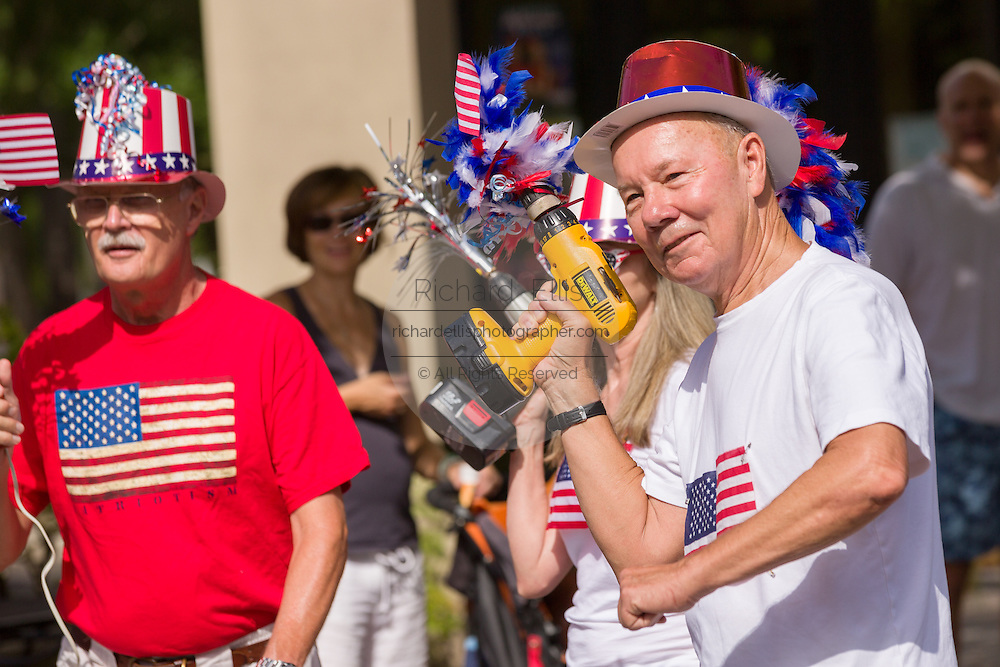 "Members of the ""Precision Drill Team"" perform during the I'On neighborhood Independence Day parade July 4, 2015 in Mt Pleasant, South Carolina. The team parades using battery operated drills as their novelty."
