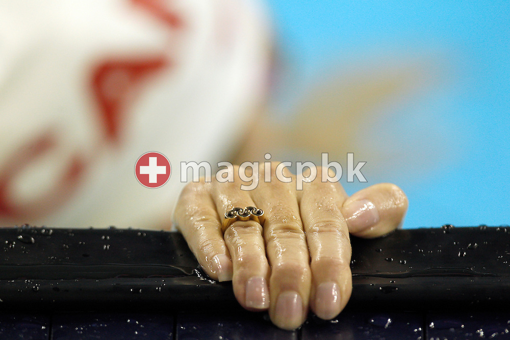 Audrey LACROIX of Canada wears a ring in the shape of the olympic logo during a training session during the 14th FINA World Aquatics Championships at the Oriental Sports Center in Shanghai, China, Tuesday, July 26, 2011. (Photo by Patrick B. Kraemer / MAGICPBK)