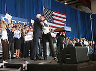 US Republican presidential nominee Senator John McCain (R-AZ) .is introduced by his running mate Alaska Govenor Sarah Palin at a campaign rally in Cedar Rapids, Iowa, September 18, 2008.