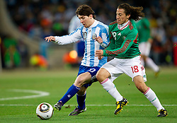 Lionel Messi of Argentina vs Andres Guardado of Mexico during the 2010 FIFA World Cup South Africa Round of Sixteen match between Argentina and Mexico at Soccer City Stadium on June 27, 2010 in Johannesburg, South Africa. (Photo by Vid Ponikvar / Sportida)