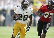01 SEPTEMBER 2007: Iowa running back Damian Sims (28) runs away from Northern Illinois strong safety Alex Kube (37) in Iowa's 16-3 win over Northern Illinois at Soldiers Field in Chicago, Illinois on September 1, 2007.