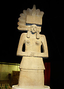 Stone sculpture of Tlazolteotl an earth goddess associated with carnal sin. Huastec culture, AD 900-1521, Mexico.  Pre-Columbian Mesoamerican Religion Mythology