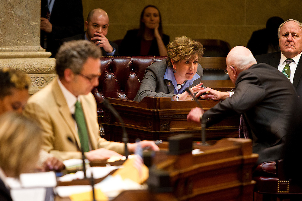 MADISON, WI — FEBRUARY 25: State Senator Jennifer Shilling discusses with Senator Fred Risser during a senate hearing over the controversial right-to-work legislation in Senate Bill 44.