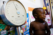 Sixteen-month-old Emmanuel Ngora Kwame sits on a scale at the NDA health center in Dimbokro, Cote d'Ivoire on Friday June 19, 2009.