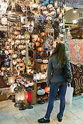 Western tourist shopping inside The Grand Bazaar, Kapalicarsi, great market in Beyazi, Istanbul, Republic of Turkey