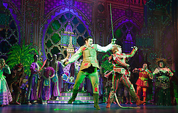 "© Licensed to London News Pictures. 08/12/2011. London, England. Stage fight between Richard Calkin as the Rat King and Actor and Dancing on Ice 2011 Winner Sam Attwater. Dick Whittington panto starring Dame Edna Everage (Barry Humphries) as the ""Saviour of London"" opens at the New Wimbledon Theatre, London. The show, written and directed by Eric Potts is scheduled to run to 15 January 2012. Photo credit: Bettina Strenske/LNP"