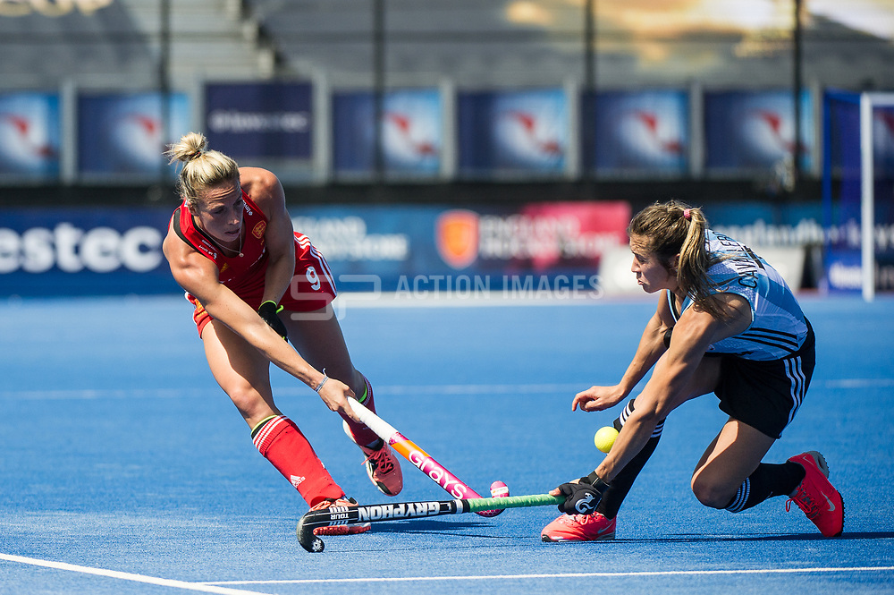 England's Susannah Townsend finds her pass partly blocked by Martina Cavallero of Argentina. England v Argentina, Lee Valley Hockey and Tennis Centre, London, England on 10 June 2017. Photo: Simon Parker