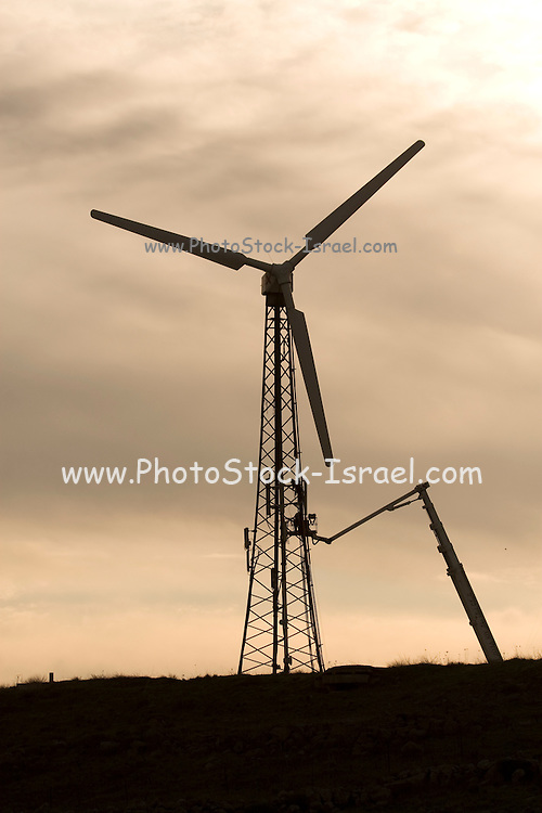 Israel, Golan Heights, Fixing a wind turbine at sunset