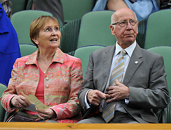 Sir Bobby Charlton with his wife Norma  in the Royal Box during Mariana Duque Marino from Colombia and <br /> Laura Robson of Great Britain game on Centre Court on day 5 of The All England Lawn Tennis Club, Wimbledon, United Kingdom, Robson went on to win the game.<br /> Friday, 28th June 2013<br /> Picture by Andrew Parsons / i-Images