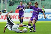 Firenze 05/03/2006<br /> Fiorentina-Siena<br /> Nella foto legrottaglie in scivolata su jorgensen<br /> Photo Luca Pagliaricci Graffiti