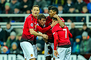 Marcus Rashford (#10) of Manchester United celebrates Manchester United's second goal (0-2) with Manchester United team mates during the Premier League match between Newcastle United and Manchester United at St. James's Park, Newcastle, England on 2 January 2019.