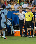 FRISCO, TX - JUNE 22:  Sporting Kansas City head coach Peter Vermes has words with an official after C.J. Sapong #17 was booked with a red card against FC Dallas on June 22, 2013 at FC Dallas Stadium in Frisco, Texas.  (Photo by Cooper Neill/Getty Images) *** Local Caption *** Peter Vermes