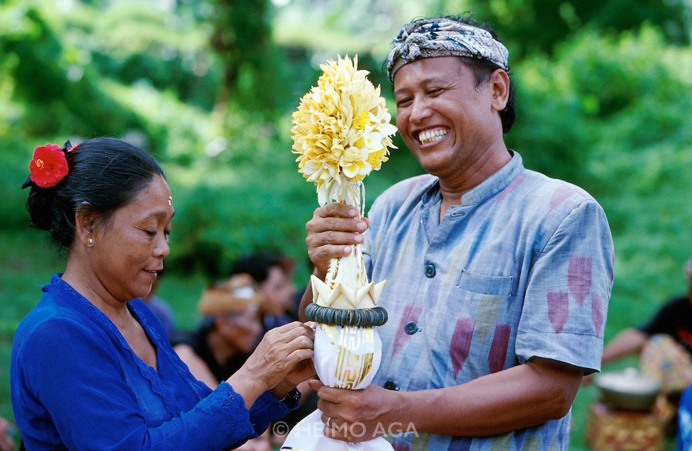 Traditional Balinese Funeral. After a hindu ritual and the cremation of the body, family members fill the relics and ashes into an empty coconut shell, which is later carried in front of  a procession to the beach and dispersed at sea.